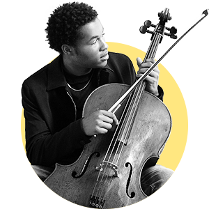 Sheku Kanneh holds his cello