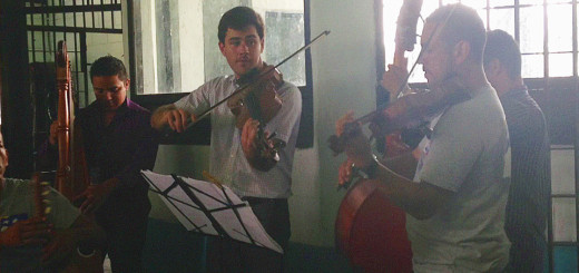 Nathan Schram plays violin with inmates