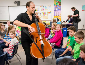 Mike Block delights students with his strapped cello