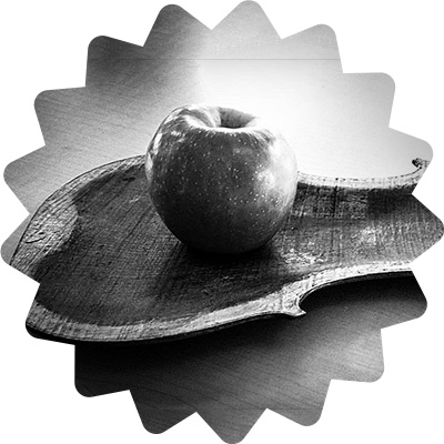 An apple on a violin platter