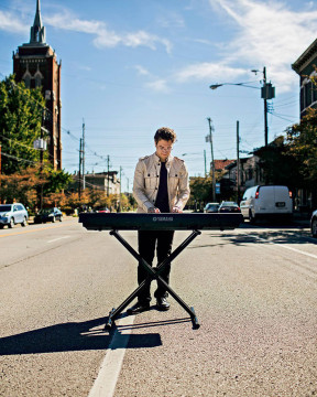 Teddy Abrams plays a keyboard in a Louisville street