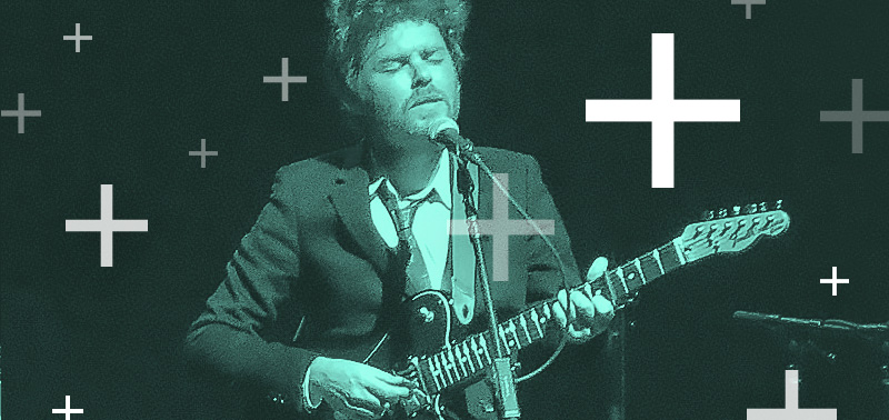 Gabriel Kahane plays guitar. Graphic pluses float around him.