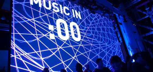 "Silhouettes of people against a screen that reads ""MUSIC IN :00"""
