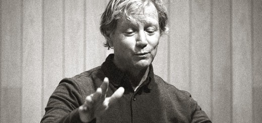 Mark Adamo speaks and gestures. Photo by Larry Ligget