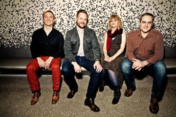 Spektral Quartet sit against a speckled wall