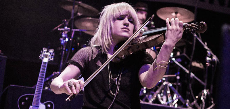 Anna Bulbrook plays violin on stage
