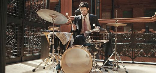 A drummer plays in an ornate building