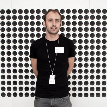 Tristan Perich stand in front of his Microtonal Wall