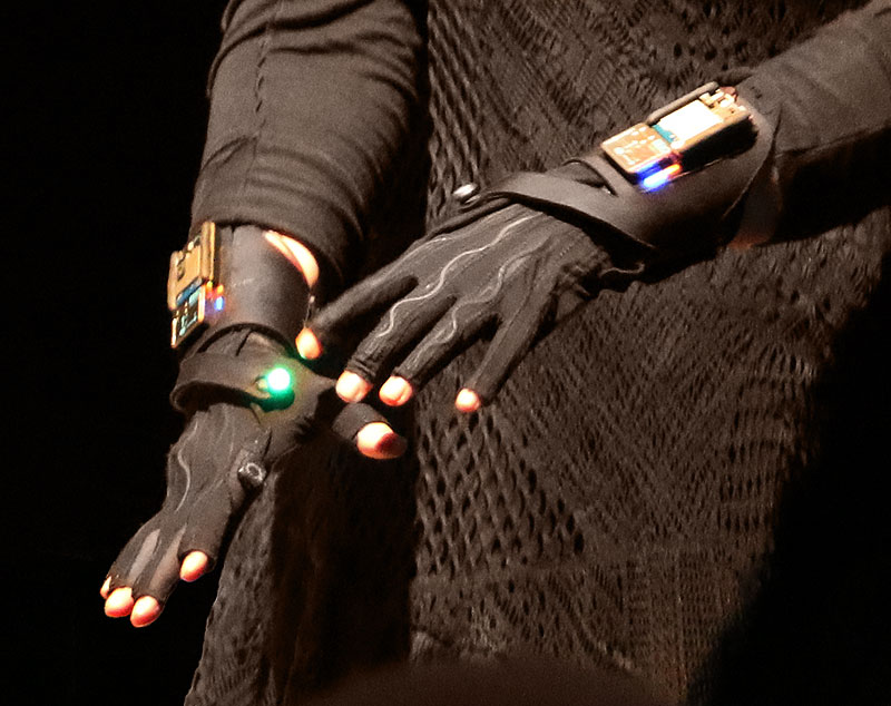 Black, fingerless gloves with microchips and lights