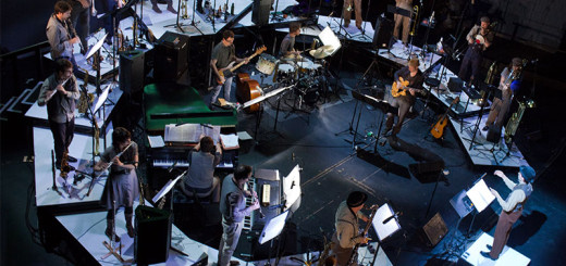 aerial view of twenty musicians playing in a circle