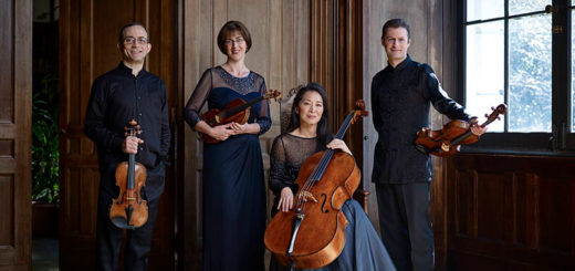 Brentano Quartet pose with their instruments