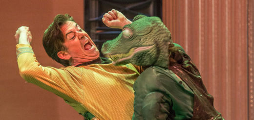 A space captain fights off an alligator-headed alien