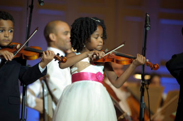 A young violinist performs