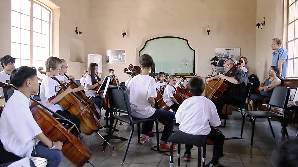 A student orchestra performs in the Glendale train station