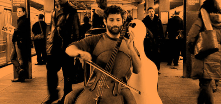 Dale Henderson plays cello in a subway