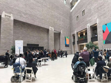 Patients listen to a liver performance in a hospital atrium