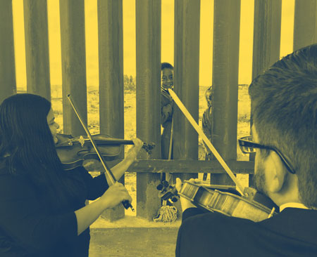 The University of Texas at El Paso (UTEP) String Quartet performs at the border.
