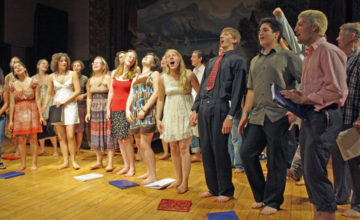 Students sing on stage