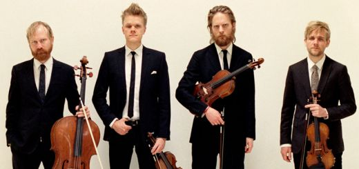 Danish String Quartet stand with their instruments
