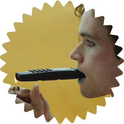 A man lights a remote control in a burst shape