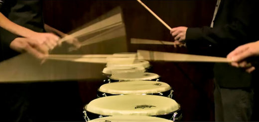 a line of drummers drum