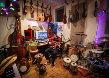 Jacob Collier in his room of instruments