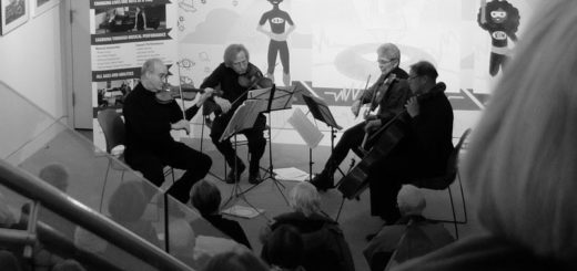 A quartet performs in a gallery