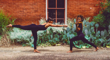 Two violinists in yoga poses