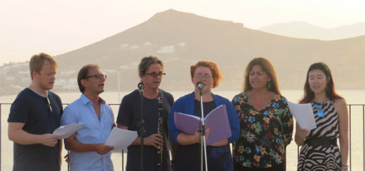 A chorus performs in front of a mountain