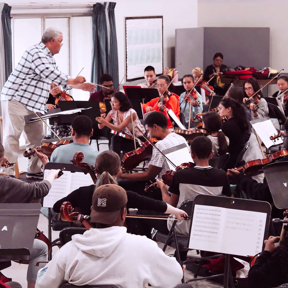 A student orchestra practices