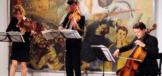 A string ensemble performs in front of a painting