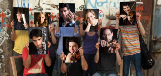 A group of people hold up head shots in front of their faces