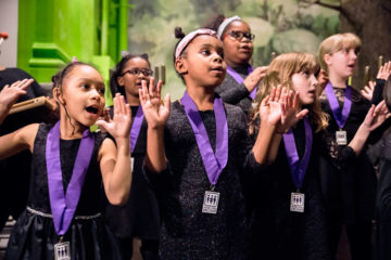 Young girls sing in a choir
