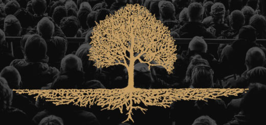 Gold tree in grayscale photo of backs of audience